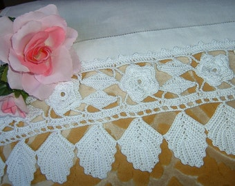Roses and leaves make up the lace for border. White cotton crochet border. Lace Italian tradition. To order.