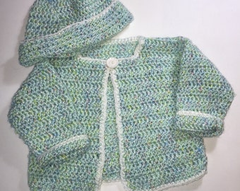 Layette: sweater and hat in green, sweater, hat and afghan in pink.