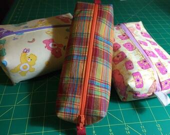 Medium zip totes: carebears, elephants, plaid.
