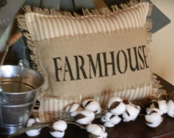 """FARMHOUSE 12""""x14"""" Toss Pillow with """"Farmhouse"""" Stenciled in Black. Biege/Creme """"Ticking"""" Fabric with Burlap Back & Fringe"""