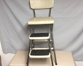 A Nice Cream Color COSCO Metal Kitchen Step Stool Chair with Pull out Steps, Plant Stand, Step ladder