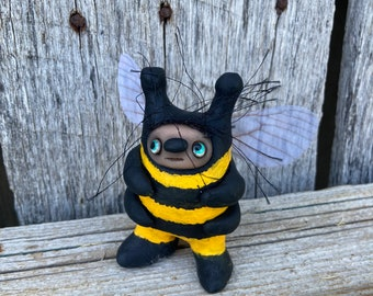 Bee with blue eyes
