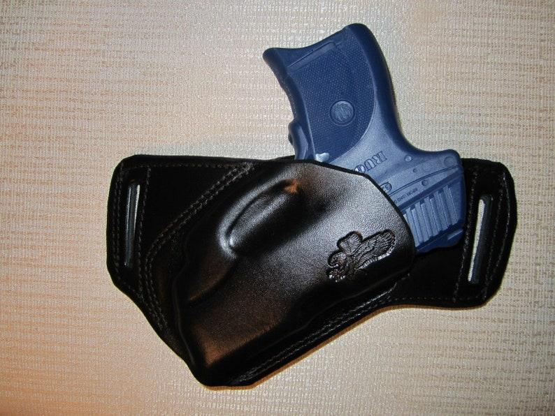 RUGER LC9 with Ct laser, formed leather sob, owb belt holster, right hand,  ultra slim design