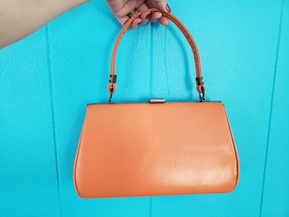 Beautiful, vintage 60's, pumpkin orange, vinyl han