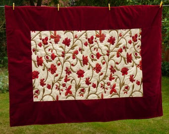 Quilt, red cream and green wholecloth crewel work centre, velvet borders . Handquilted large lap quilt/single bed topper, 168cm x  125 cm.