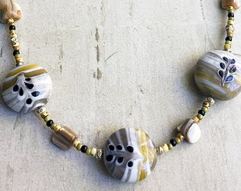 3 Hand Painted Ceramic Beads with Leaf Design with Tribal Hill Floral Stamped Silver, Shell Nuggets and Rounds, Agate Rounds & Seed Beads
