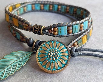 Leather Wrap Bracelet has two hand woven, designed sections of Tila, Half Tila, and Seed Beads with Czech Gold Daisy Button and Leaf Charm