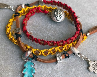 3 Wrap Brown Saddle Leather Bracelet macramed with Amber and Garnet Silk Cord with sliding Silver and Enamel Charms & hammered Silver Button