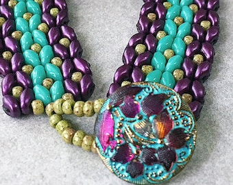 Matubo Vega on Chalk and Opaque Turquoise Duos are hand woven with gold Seed Beads and completed by Czech Glass Lacy Flower Design Button