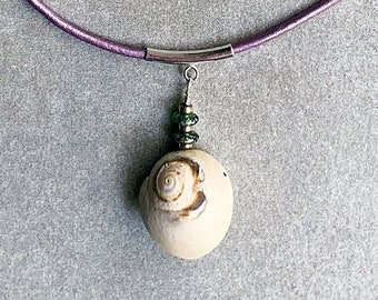 Handpicked Moon Snail from North Carolina with Czech Emerald Discs and Sterling Rounds hang from a Sterling Tube on Violet Leather Cord