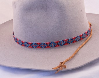 6975bcf650af20 Geometric Design Beaded Hatband in Colors of Reds, Blues and Dark Gold.  This Celtic Cross Design Looks Great with Cowboy Felt and Staw Hats