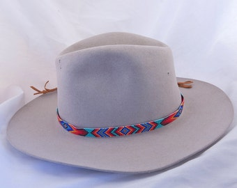 72a6bac8301 Beaded Geometric Design Hatband in Blues and Reds on a Turquoise  Background. Hand made by the Artist with Glass Seed Beads