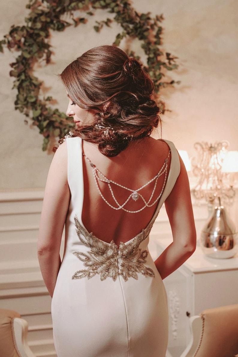 Meermin trouwjurk met parels op de rug