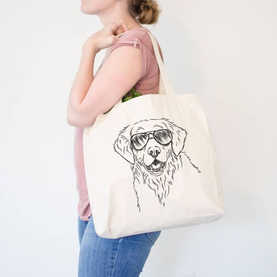 White canvas tote bag featuring a Golden Retriever on the front in black drawing.