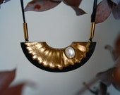 Pecten necklace - Ark shaped statement pendant made from black sand, gold pigments and a freshwater pearl on black cord