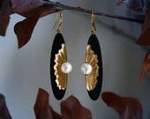 Oyster earrings - long oval dangle earrings made from black sand, gold pigments and freshwater pearls on gold plated french hooks