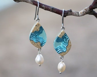 Bay dangle earrings crafted from beach sand and aquamarine blue resin with fresh water pearls on allergy friendly stainless steel hooks