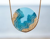 The Abyss - Beach necklace with round pendant handmade from sand and aqua blue resin on cord