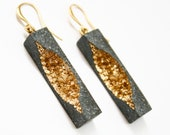 Burra long rectangle dangle earrings made from concrete and gold pigments