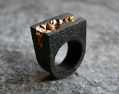 Anakie tapered statement ring made from concrete and gold pigments