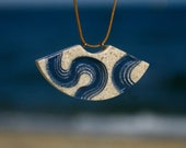 The Meander - Surfer necklace handmade from beach sand and ultramarine blue resin on adjustable cord