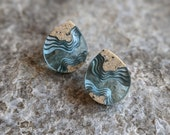 Ridge ear studs - Aquamarine blue tear drop shaped ear studs made from beach sand and resin featuring topographic layers