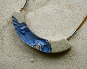 The Lagoon - Modern curved beach necklace handmade from beach sand and ultramarine blue resin on adjustable cord