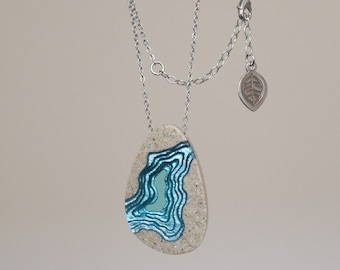 Chasm necklace - asymmetrical tear drop beach necklace crafted from beach sand and aquamarine blue resin