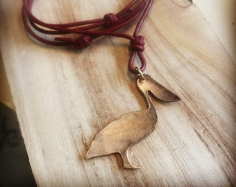 Handcrafted Bronze Pelican Charm Necklace on Leather