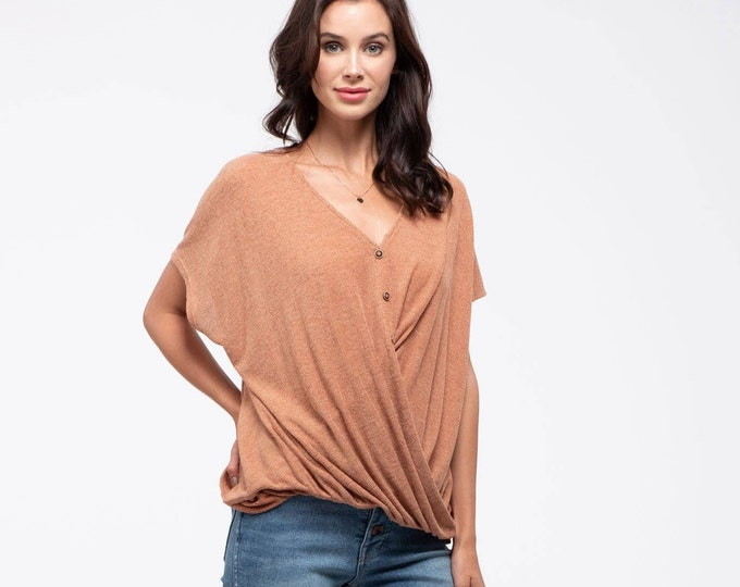 Button-down twist-hem top.