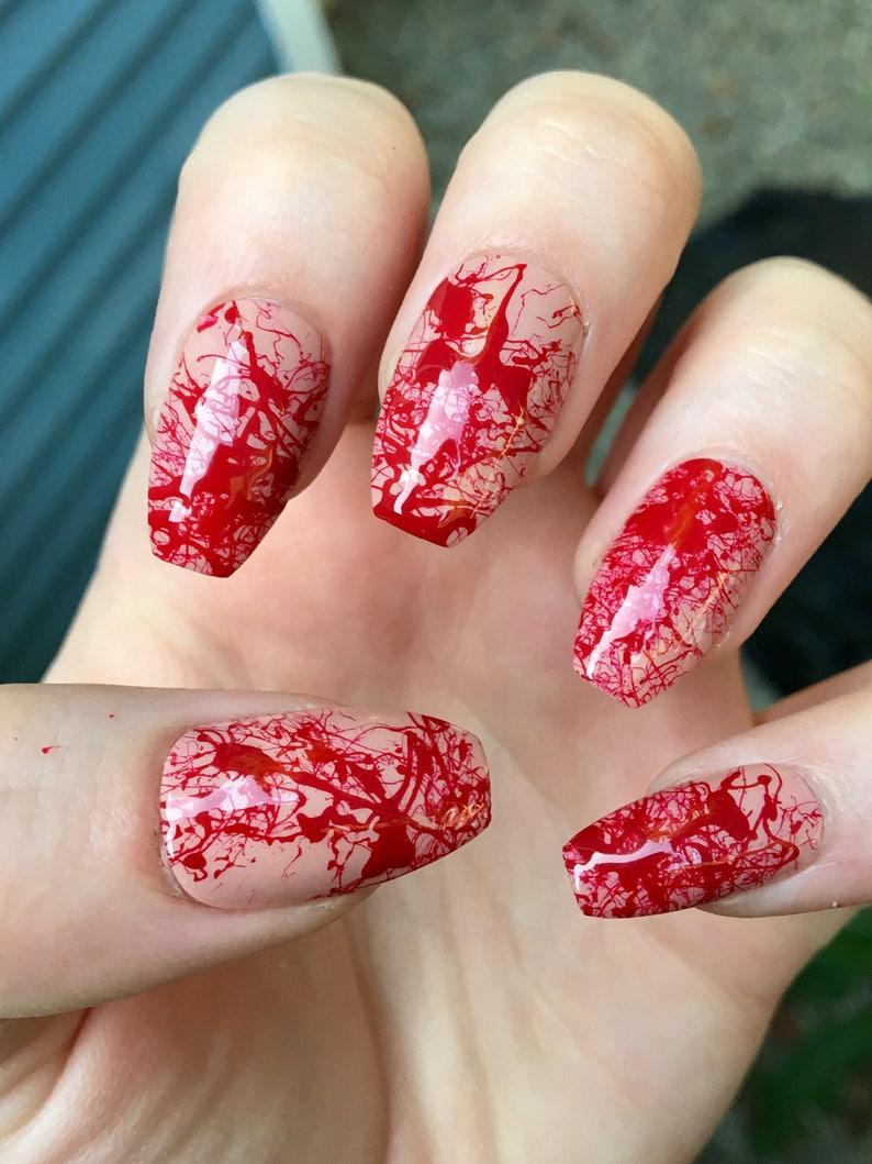 bloody nails costume nails stiletto nails white nails image 0