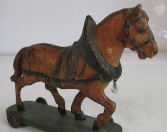a very small antique toy draught-horse papier maché
