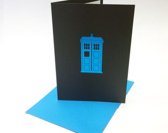 Dr Who inspired greeting card, with a tardis design printed in blue foil on black card, Whovian birthday. Size A6.