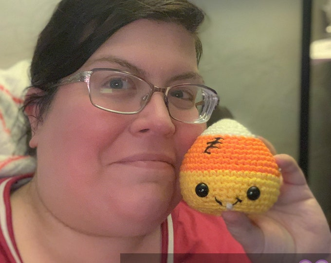 Cuddly amigurumi candy corn plush toy
