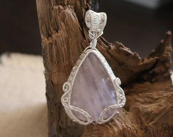 Rose quartz pendant wrapped in non-tarnish silver plated wire