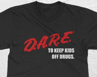 DARE Vintage Shirt With The 80s or 90s clothing retro shirt vibe. Instant classic. Dare t-shirt Unisex in 2 styles. Fast Free Shipping