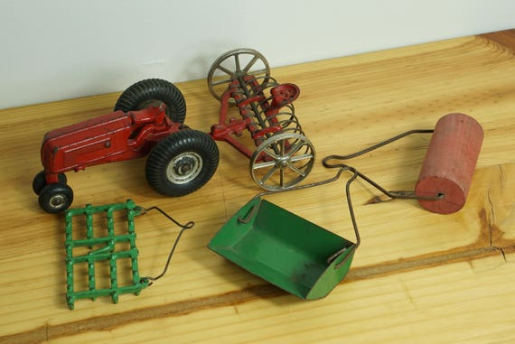 Cast Iron Arcade Toy Farm Tractor, Hayrake and other Implements