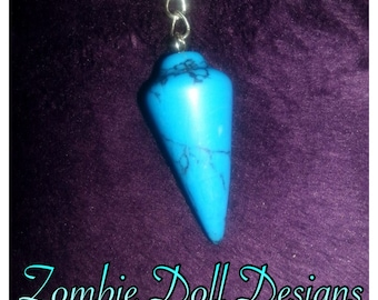 Darling turquoise pendulum necklace! A wealthy stone :-)