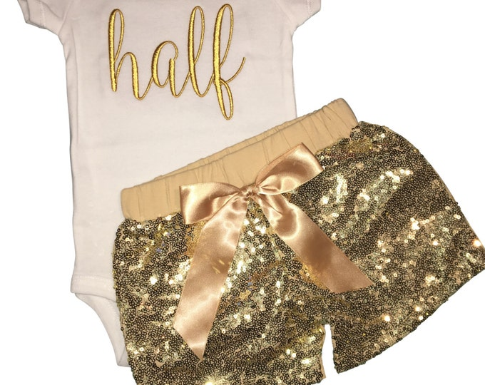"Girls cursive ""half"" birthday outfit with gold sequin shorts / hot pants and onesie"