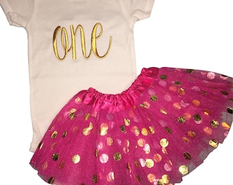 """Girls cursive """"one"""" birthday outfit with Hot Pink/Gold Dot tutu. Choose onesie or baby tee."""