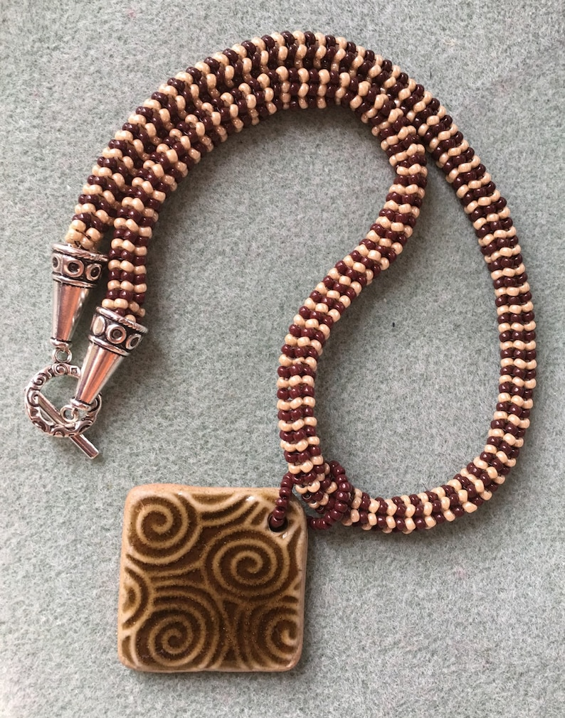 Beaded necklace with ceramic pendant image 0