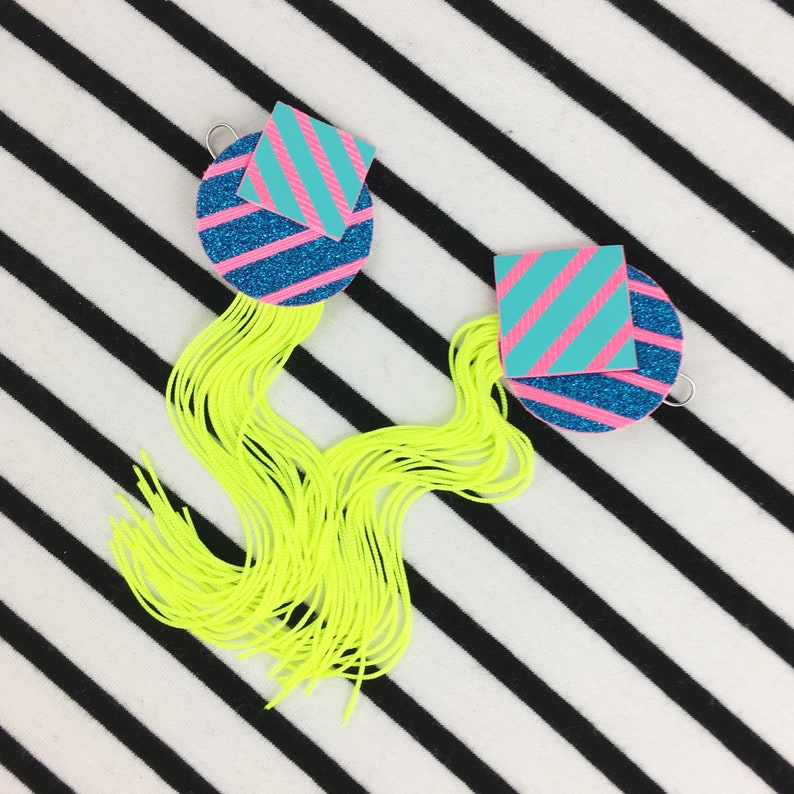 FLUORESCENT TASSEL EARRINGS ft  Geometric shapes  A square and circle in  glittery blue/pink and turquoise/pink with a neon yellow fringe