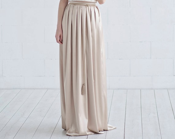 Oria - satin skirt with tassels and pockets