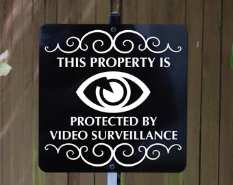 This Property Is Protected By Video Surveillance Metal Sign attached to sturdy yard stake. Free Shipping