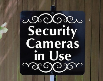 Security Cameras in Use Metal Sign attached to sturdy yard stake. Free Shipping