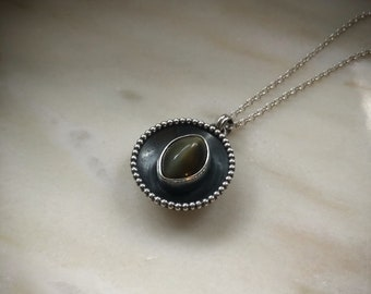 Sterling Silver pendat with a green cat's eye