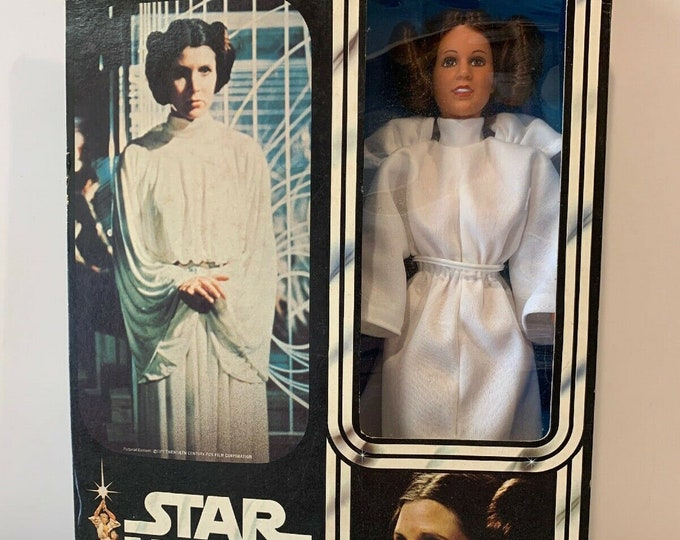 Featured listing image: Kenner Star Wars 12 Inch Princess Leia, Complete In Box 1978, Never Been Removed, Accessories Bag Still Sealed