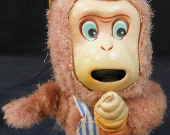 Vintage Wind-Up Monkey Eating Ice Cream Cone