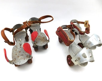 Neat-o, 1950's Globe Skate Corp children's adjustable steel roller skates with red toes or red plaid ankle straps, shiny and clean (1 pair)!