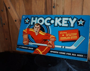 Take off 'eh!!!  To the Great White North, hoser!  Classic graphics on this 1958 Hoc-Key Game by Cadaco Ellis